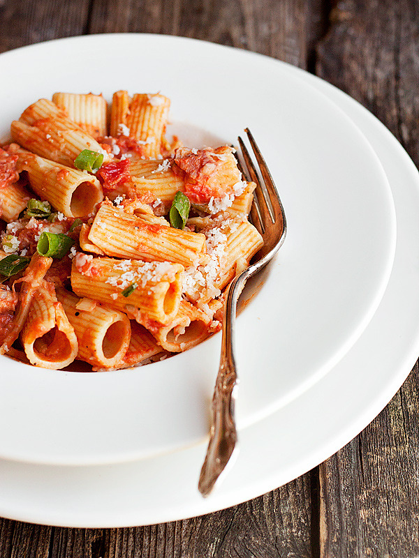 Rigatoni with pancetta and green onions in vodka sauce