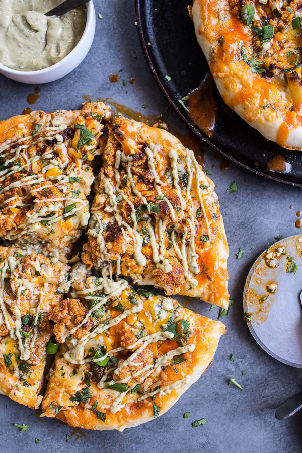 buffalo roasted cauliflower pizza with cheese & avocado drizzle
